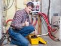 Happy handyman showing thumbs up