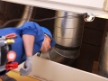 Plumber standing under a heating duct